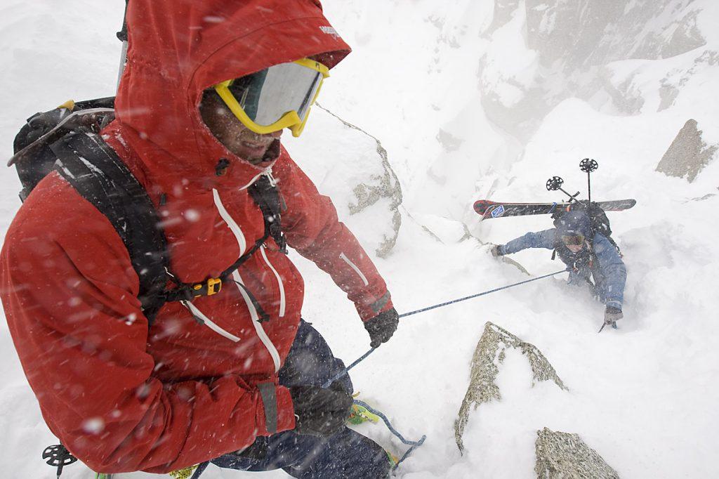 Skiiers climbing up a mountain