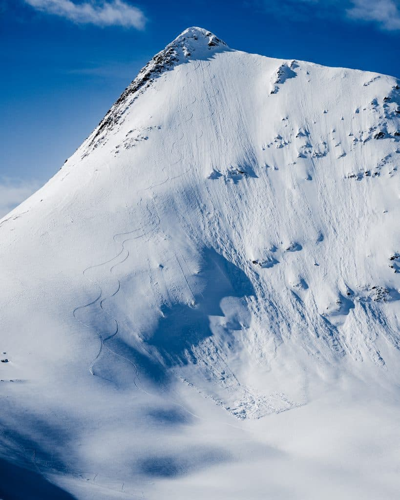 Skiing lines on mountain