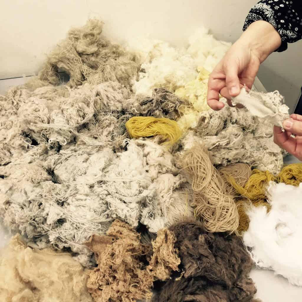 Sorting through leftover wool
