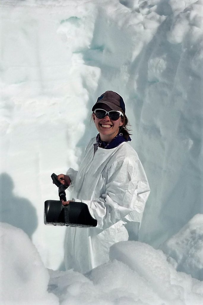 Karina digging in the snow.