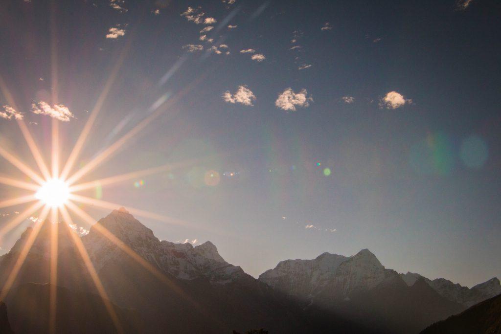 Sun shining over the mountains