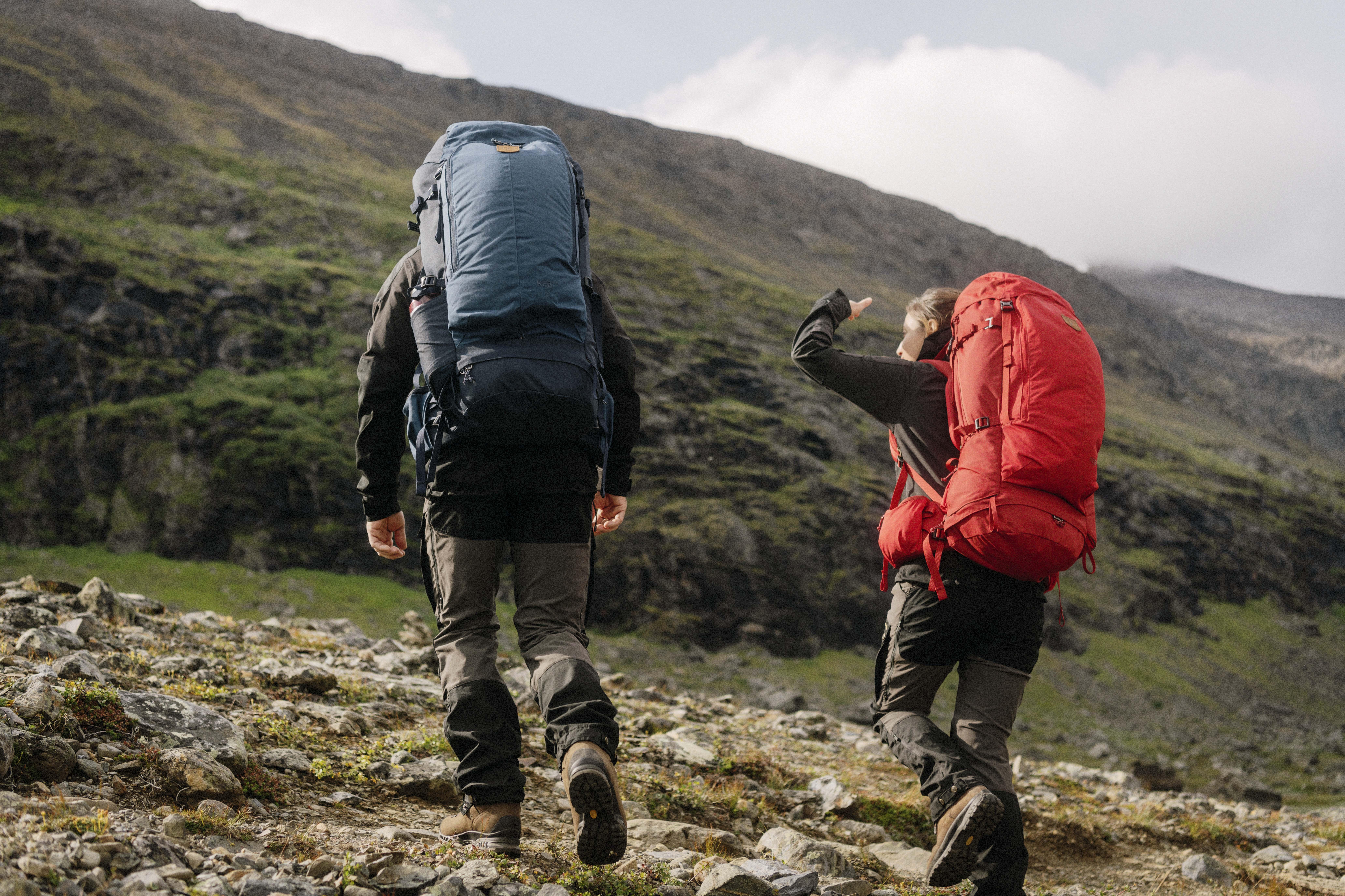 Hikers in the mountains, fjällräven backpacks, fjällräven trousers