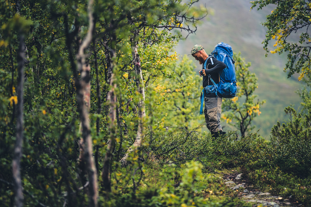 Hiker in the woods, fjällräven backpack, fjällräven trousers