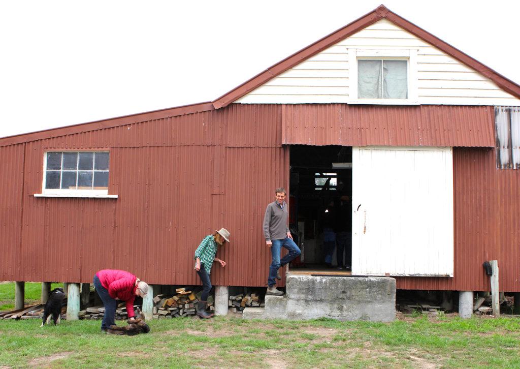 People outside a wool farm