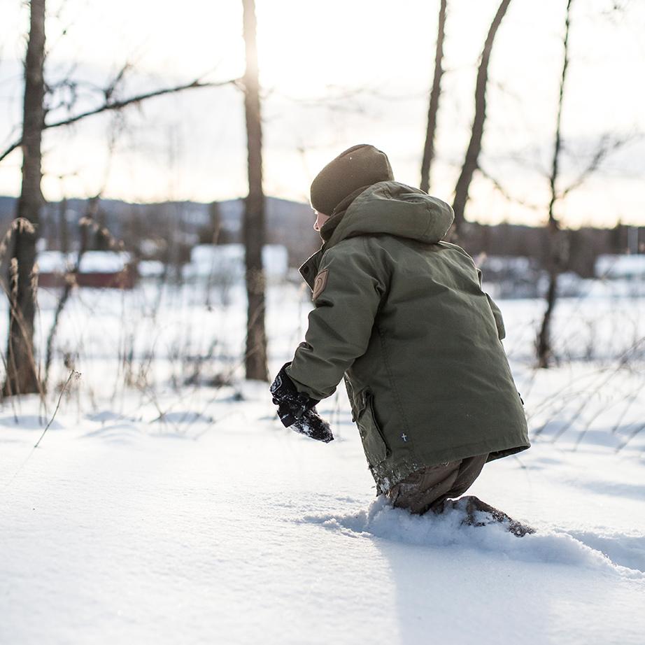 Kid running through knee deep snow